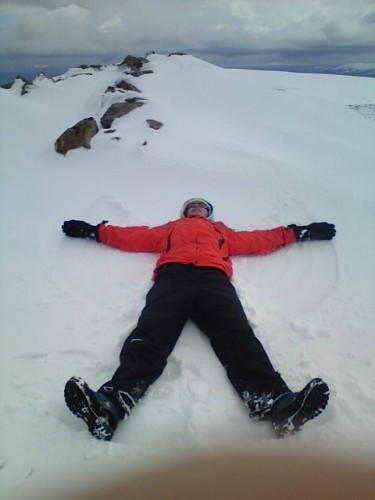Making a snow angel on a Scottish mountain.