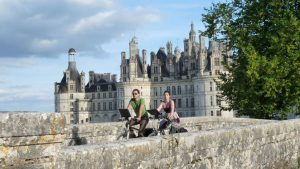 Cyclists by a chateau in Loire