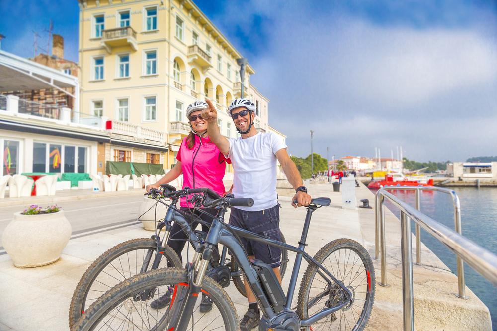 Couple on holiday on e-bikes