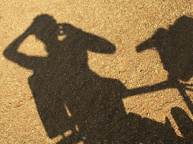 A cyclist shadow.