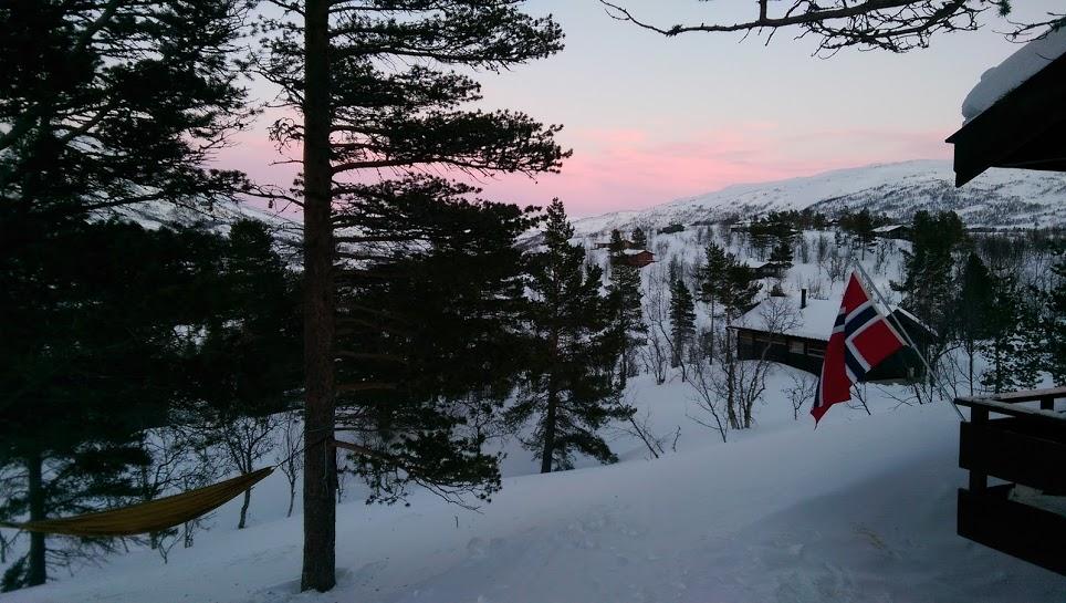 Traditional Norwegian Cabin Scene.