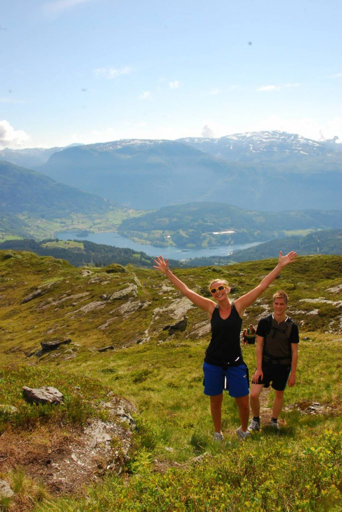 Happy walkers in the Hardangerfjord region, Norway.