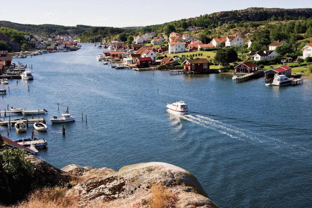 A boat cruises between Sweden's archipelago