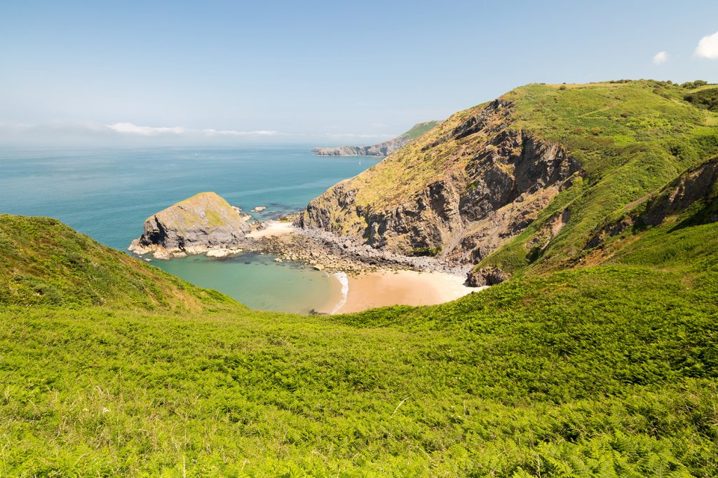 A secluded cove along the Ceredigion Coast Path.