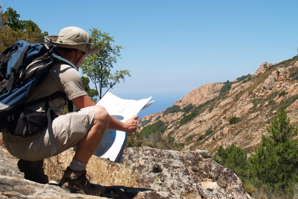 Checking the map on the Corsica: Mountains to the Sea