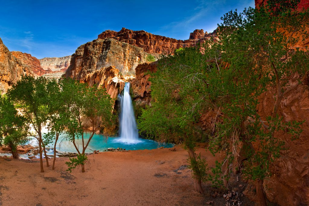 Havasupai Falls our into a crystal clear lake in the Grand Canyon