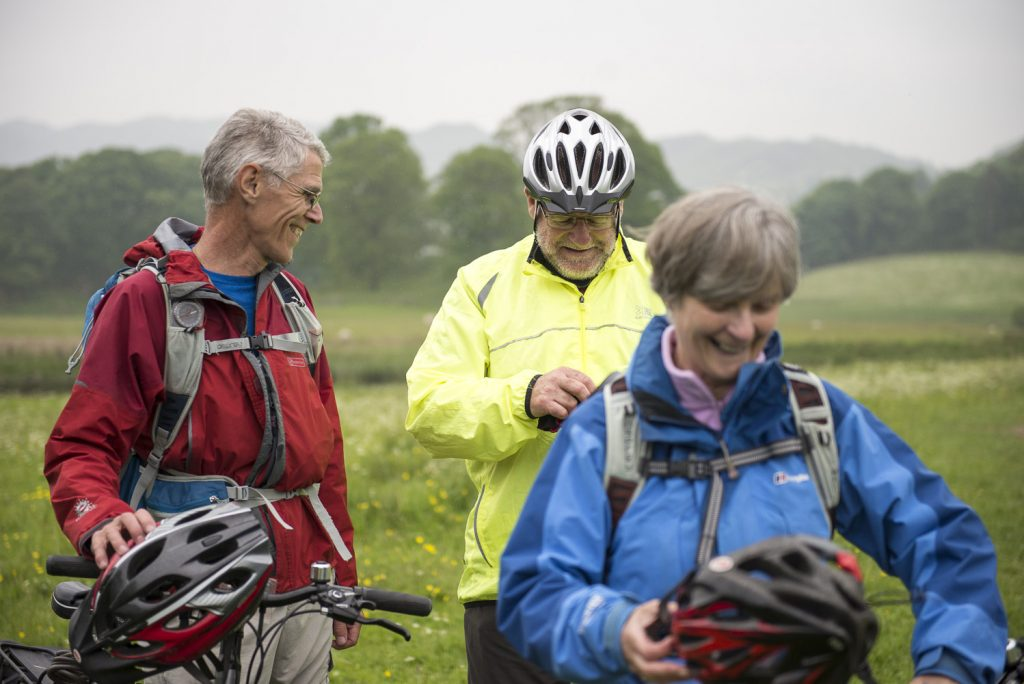 Three cyclists stop to chat on the C2C cycling route in England