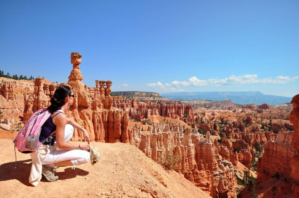 A Hiker sits a the edge of Bryce Canyon and enjoys the view