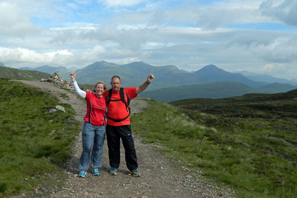 Two people celebrate walking on the West Highland Way