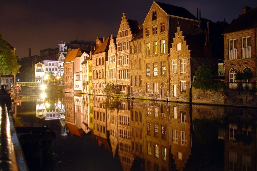 Buildings lit up on the canal in Ghent Belgium