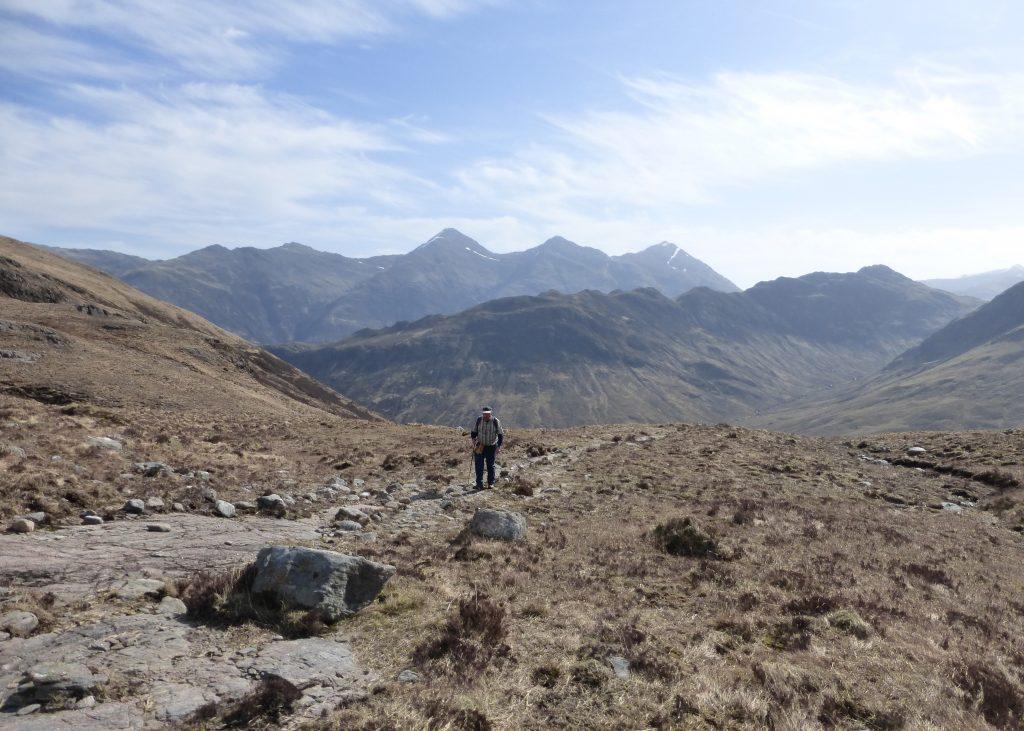 Lone walker on a path in Glen Affric, Scotland