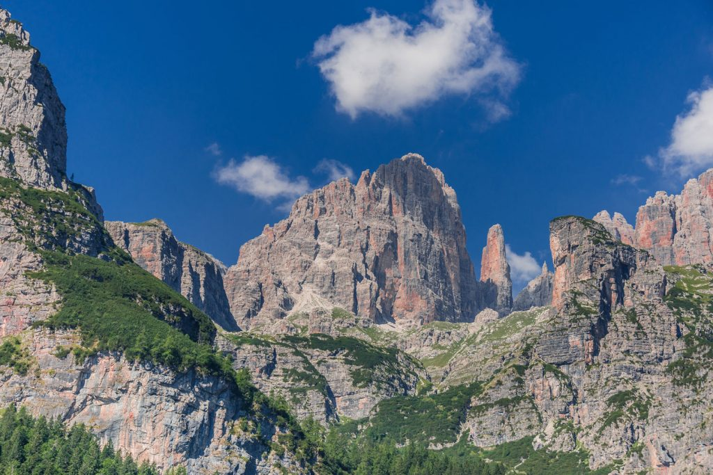 Huge sandstone cliffs rise to the sky in the Brenta Dolomites Italy