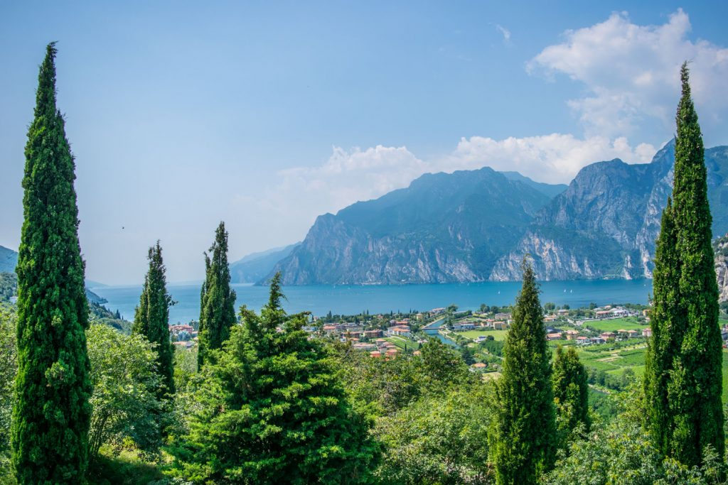 The italian town of Riva del Garda sits on the edge of lake garda with mountains in the background