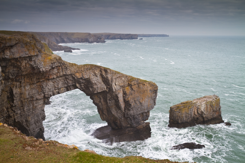 a coastal archway on the pembrokeshire coast path