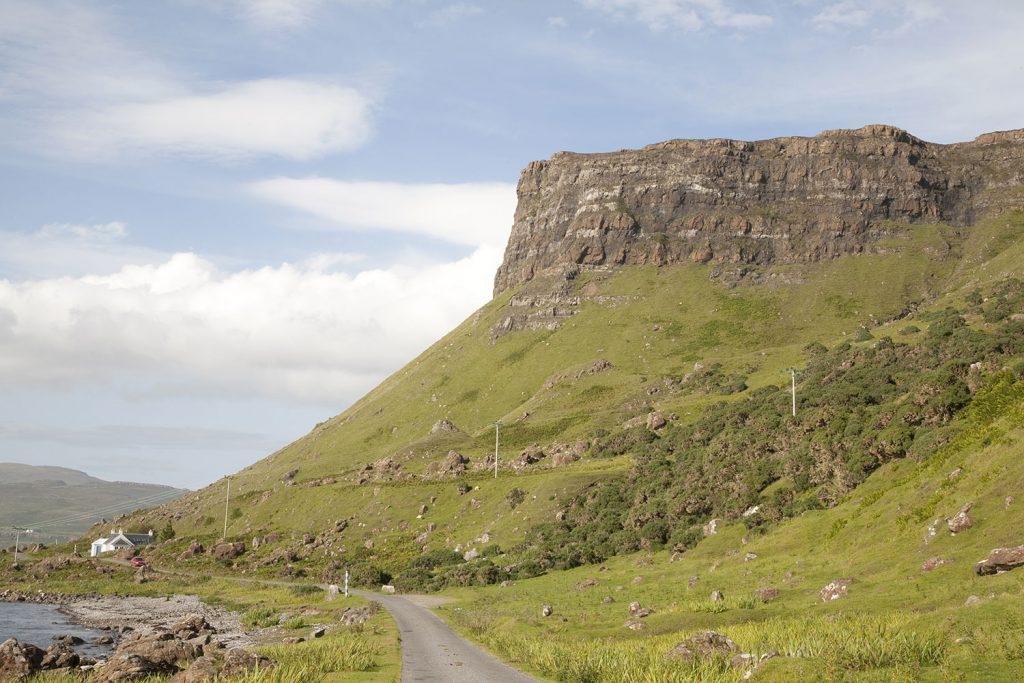 huge headland juts over road on Mull Scotland