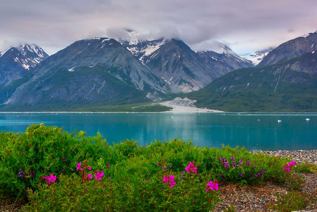 Snow capped Mountains, blue lake in Alaska