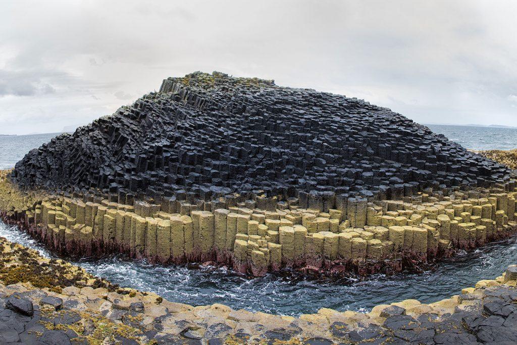 Columnar Basalt columns form an island in Staffa Scotland
