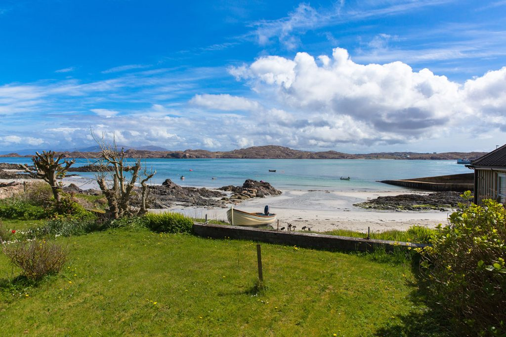white bay with clear turquoise sea, Iona Scotland