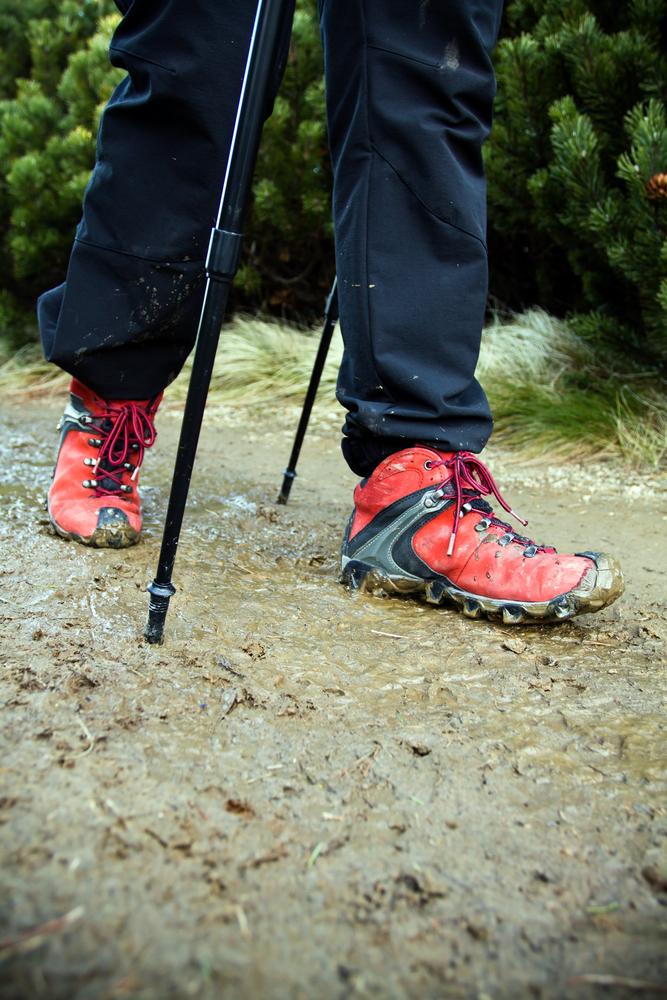 muddy boots on a muddy hiking trail