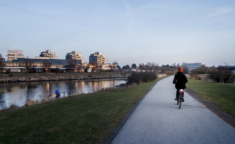 lady cyclist on a path in Malmo Sweden