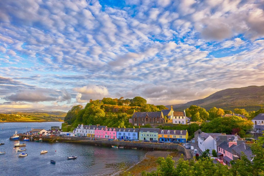 colourful buildings line the harbour in portree, skye