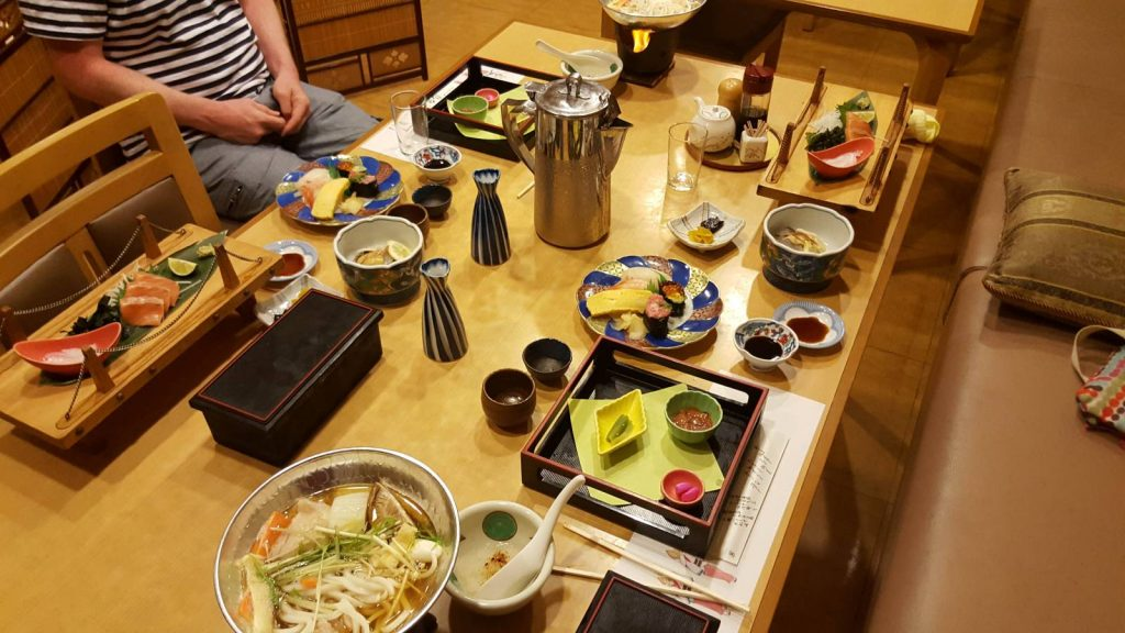 A banquet meal laid out on a ryokan table