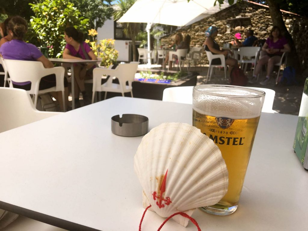 scallop shell and beer on the camino de santiago