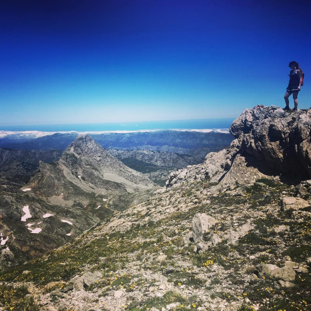 walker at the summit in the Picos de Europa