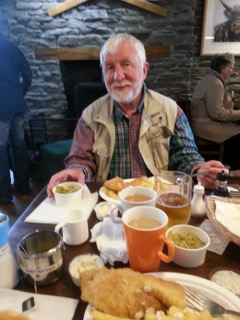 hiker with a spread of food on the west highland way