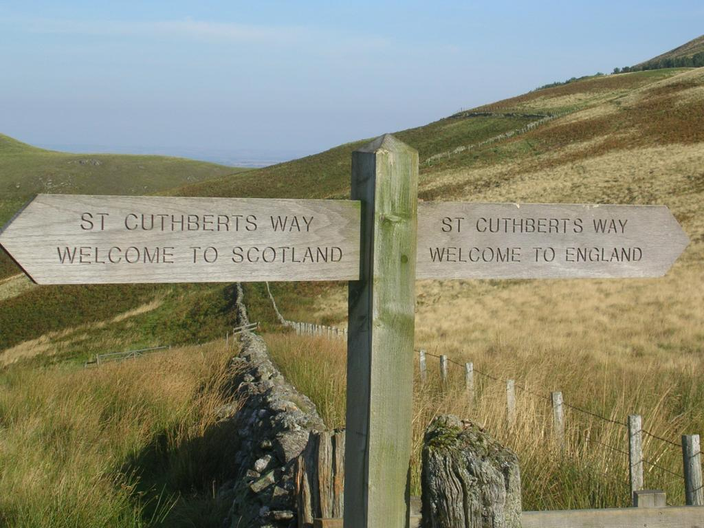 Signpost telling of the border crossing on the St Cuthbert's Way