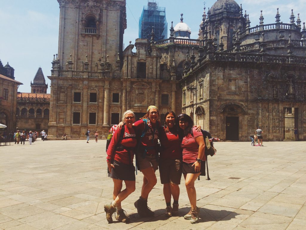 Pilgrims celebrate at the end of the Camino de Santiago