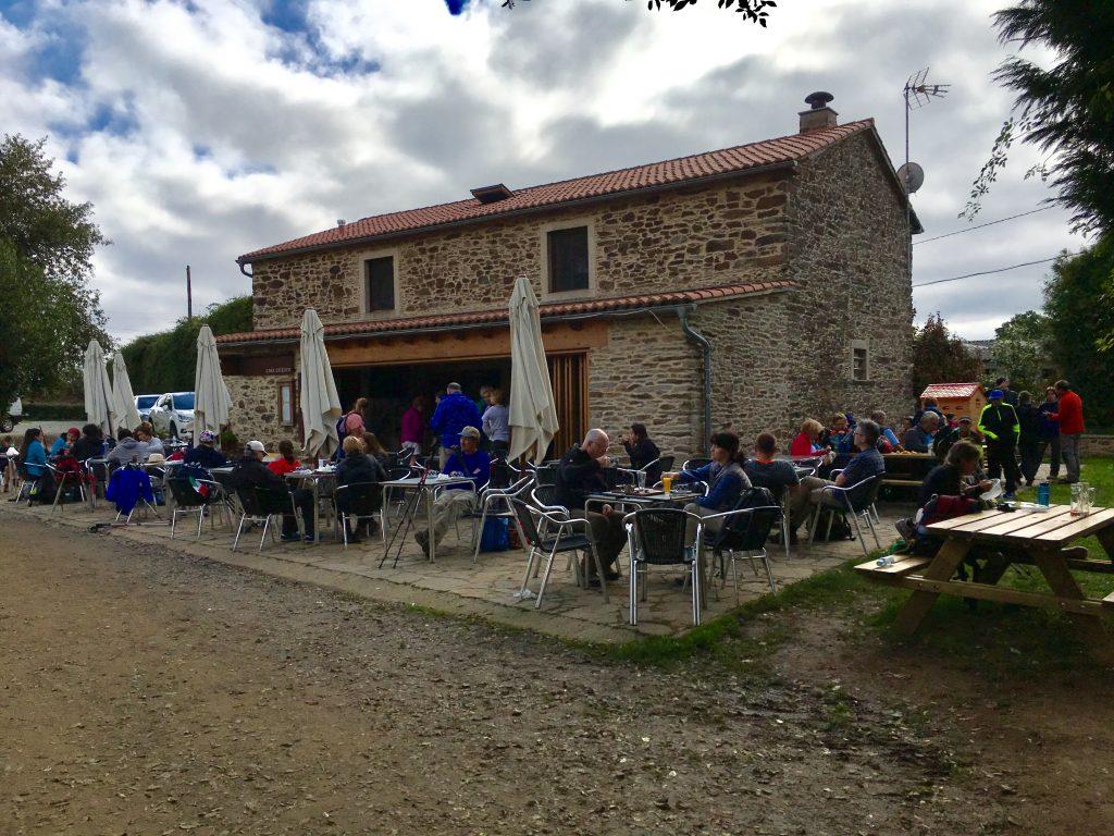 Pilgrims enjoying lunch along the Camino Frances.