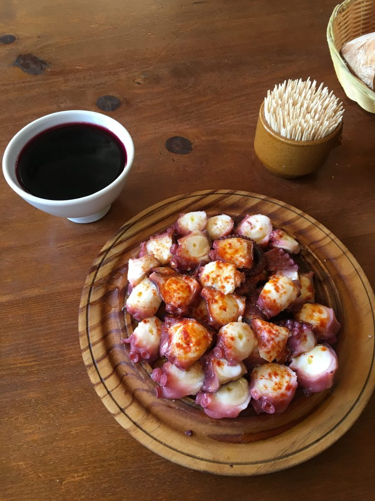 Photo of octopus and wine.