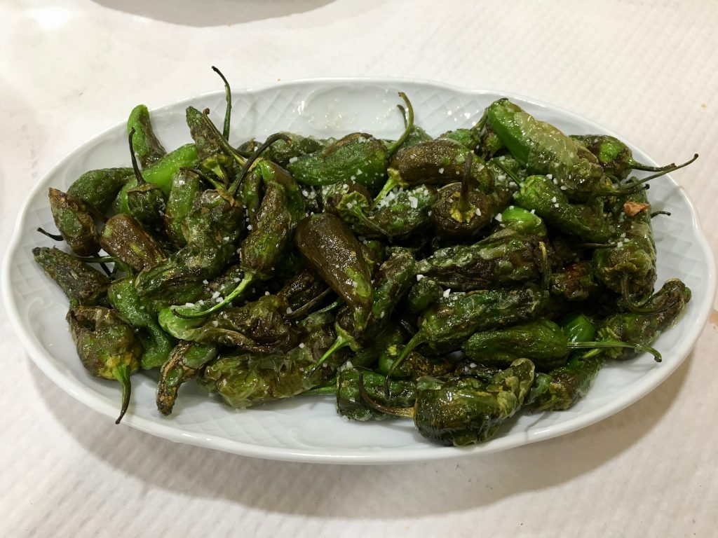 Padron peppers on a plate.