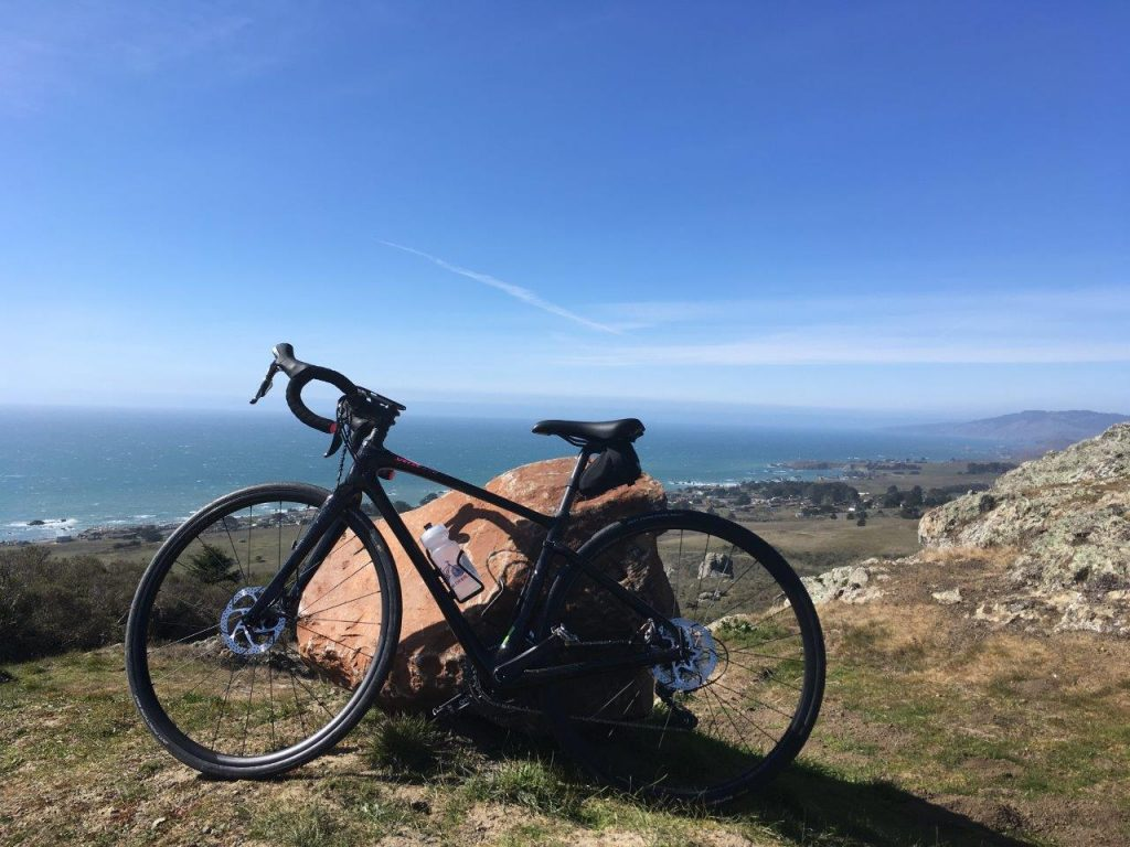 Bike in front of coastal view in the sunshine