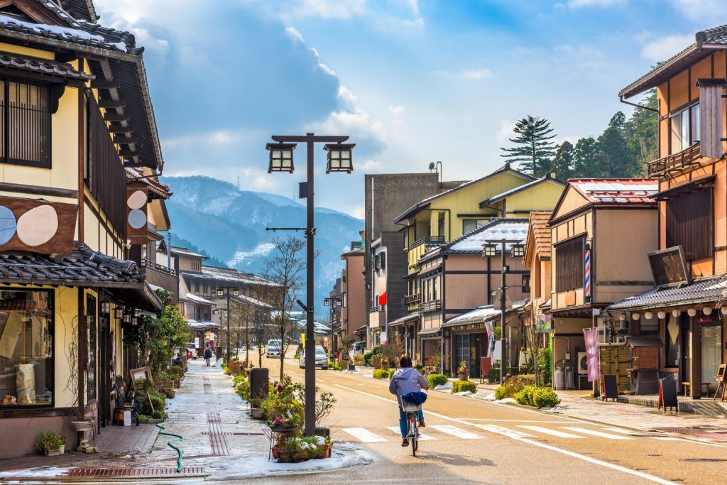 Cycling through quiet, traditional Japanese towns.